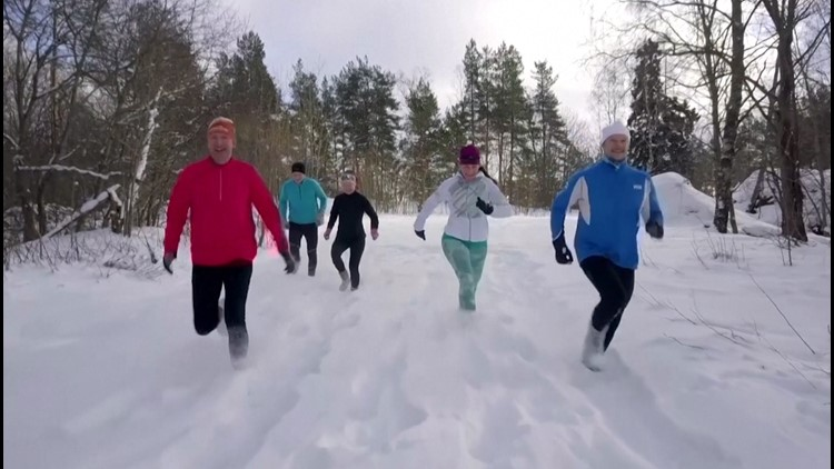 Snow Way! Finnish Runners Exercise in Deep Snow Only Wearing Socks!