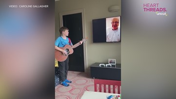 Boy practices Queen song remotely with grandpa