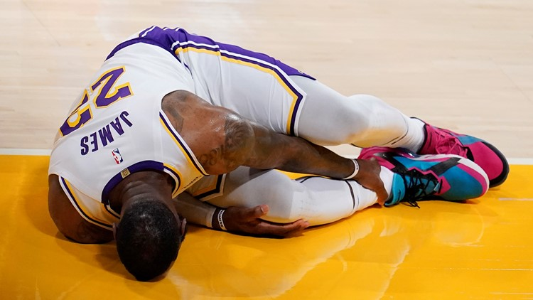 LeBron James sprains right ankle in Lakers loss to Hawks, out indefinitely