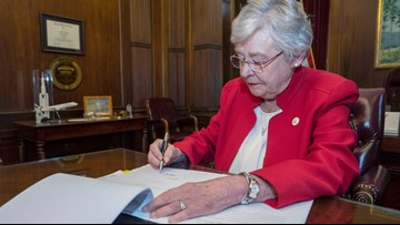 Alabama governor invokes God in signing nation's strictest abortion ban into law