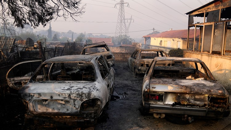 Greek fires approach Olympics birthplace, force beach rescue