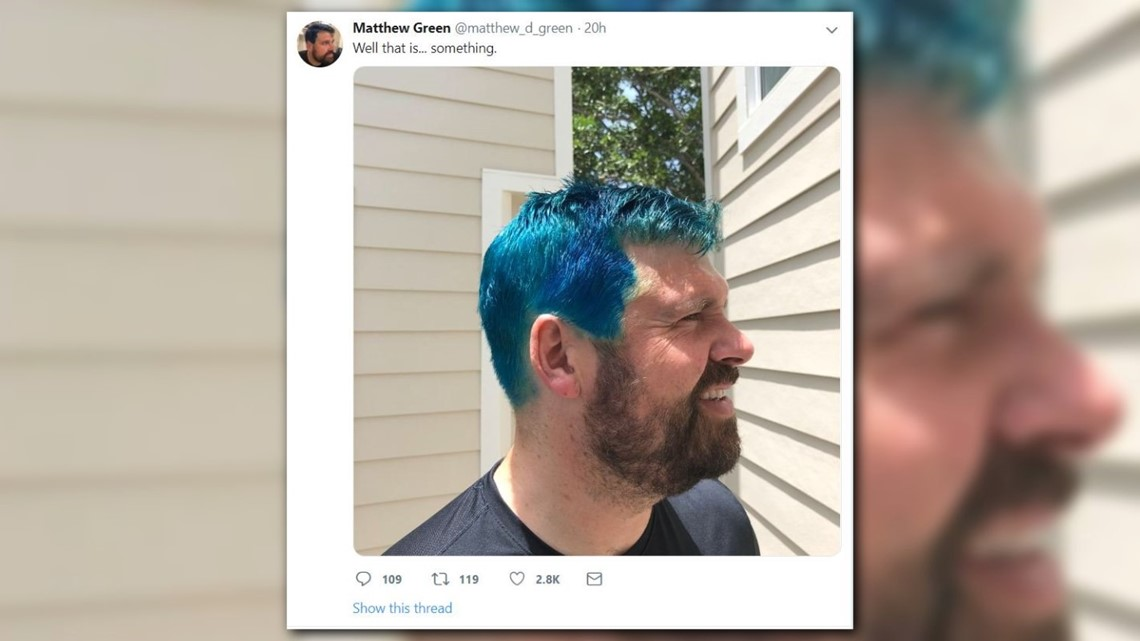 Dad dyes hair blue with son to raise money for immigration aid