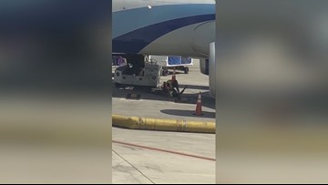 Video shows baggage handlers tussling under parked plane at SAT
