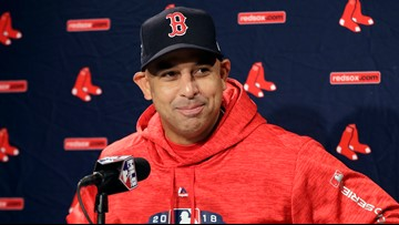 How is Alex Cora linked to the Astros cheating scandal?