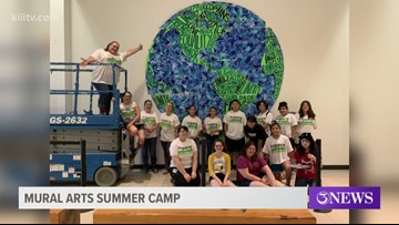 Teens learn how to paint a mural during summer camp