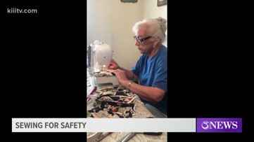 Local lady using sewing machine to sow masks