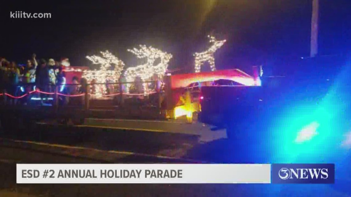 Firefighters hand out toys during holiday parade