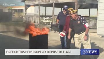 Firefighters help Fleet Reserve Association properly dispose of flags