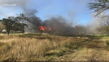 Annaville firefighters battle wind-fueled blaze at abandoned trailer