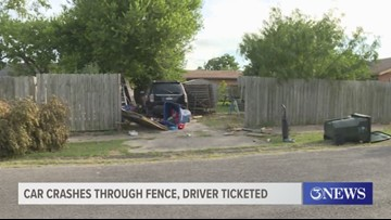 Car crashes through fence, driver ticketed