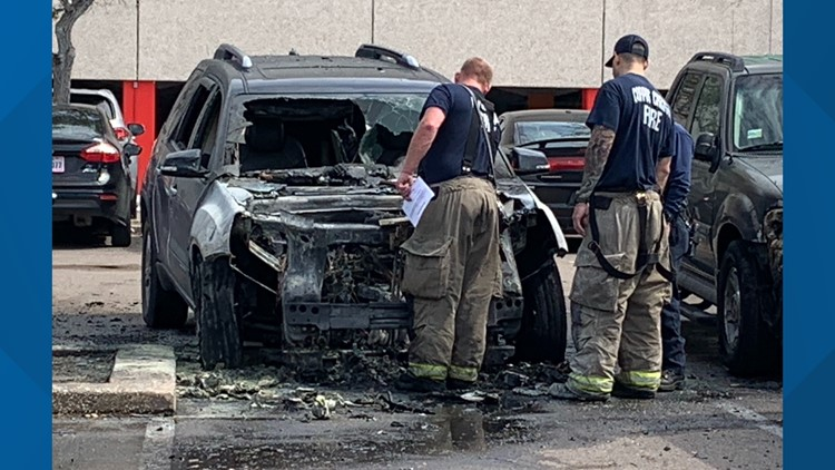 Firefighters extinguish SUV engulfed in flames in American Bank Center parking lot