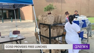 CCISD parents line up at drive-thru sites for to pick up free meals