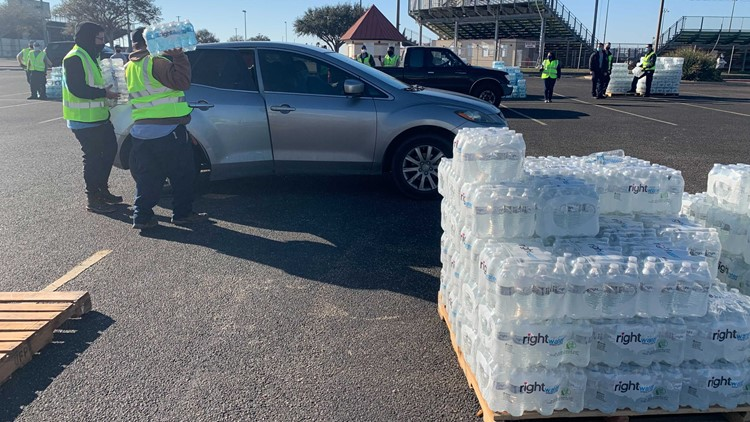 Vehicles line up as City of Corpus Christi distributes free bottled water at five locations