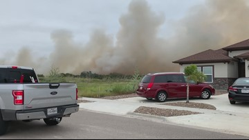 Firefighters battle large brush fire at Holly Road in Flour Bluff