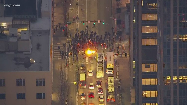 Three arrested during destructive march in downtown Seattle