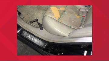 Woman chucks hatchet through car window as it drives away from North Austin gas station