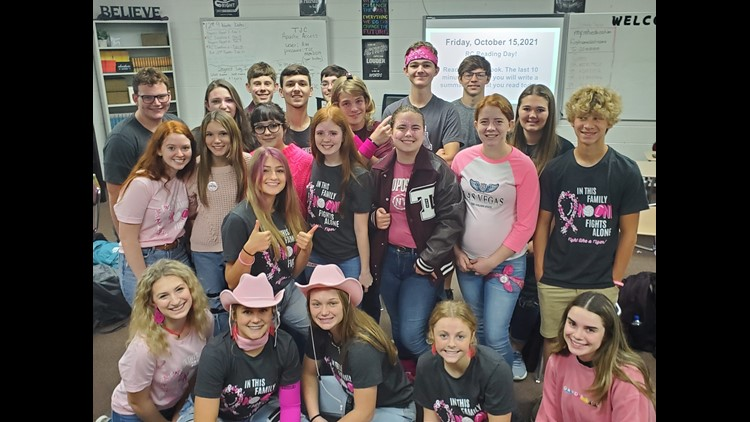 Troup high school students honor teacher battling breast cancer with a pink out pep rally