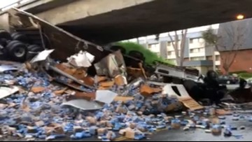 Beer truck overturns, spilling suds into the street