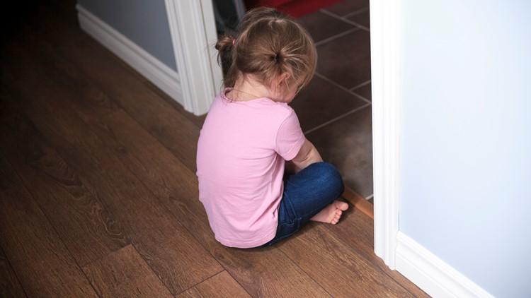 Girl sitting in doorway